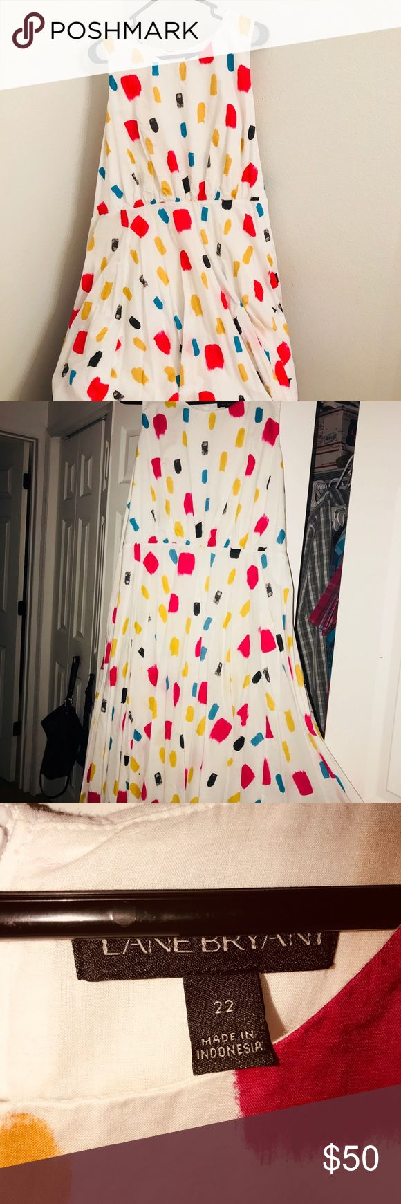 Lane Bryant plus size Printed tulip hem dress Beautiful 100% cotton fit and flare dress from Lane Bryant size 22. Zips in the back and has pockets . Very comfy and  flattering. Only worn once to a wedding reception. Lane Bryant Dresses