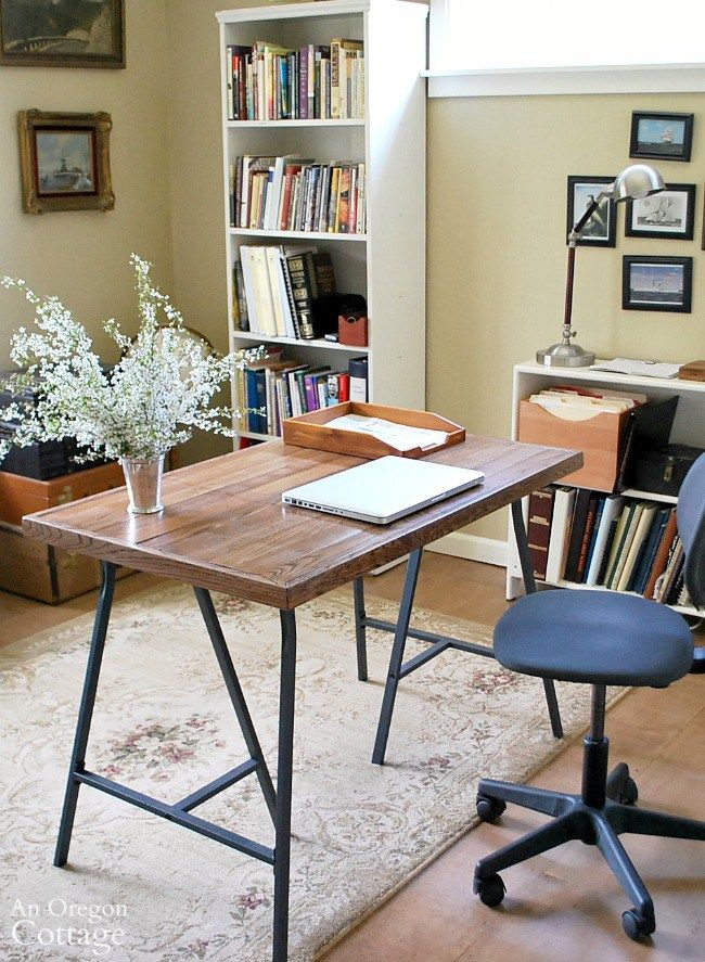 How to make a rustic industrial style table or desk with Ikea trestle legs and salvaged wood flooring for less than $30.