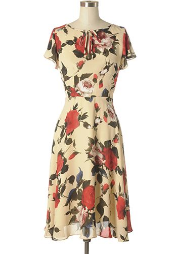 Beautiful floral printed vintage-inspired dress in cream/beige. Flutter sleeves. String tie at front neck line. Back zipper ***Fits small at waist*** 100% polyester Not stretchy Lined Hand wash cold, hang dry Women's Vintage-Style Dresses & Accessories - Canada Can't Stop Staring Dress -