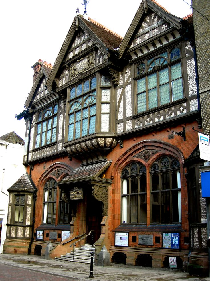 Tudor Revival Style - Half-timbering, Gothic Revival tracery and Jacobean carved porch brackets combine in the Tudor Revival Beaney Institute, Canterbury (1899)