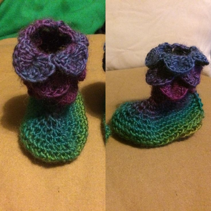 Dragon scale baby booties in a gorgeous multicolour yarn.