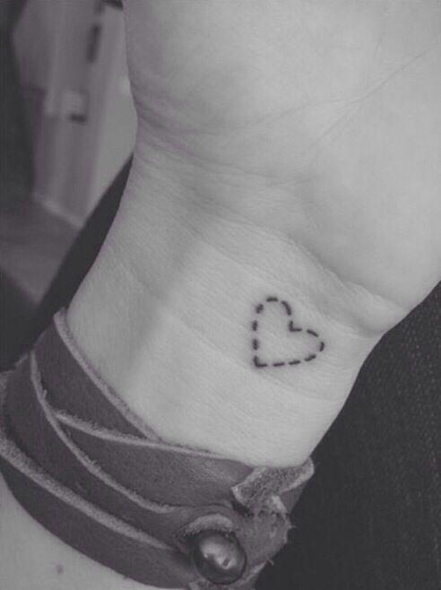 stitched heart tattoo Minimal tattoo www.tattoodefender.com #tattoo #tattooidea #tatuaggio #ink #inked #inspiring #tattooart #tattooartist #inkmaster #tattooideas #minimal #tiny #guy #girl #tattoodefender