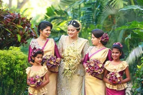 The stunning bride Maleesha sharing a moment with her brides maids and flower girls at Cinnamon Grand Colombo.