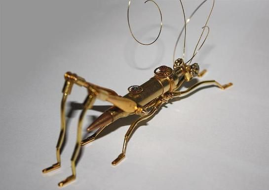 Steampunk insect made out of bullets.