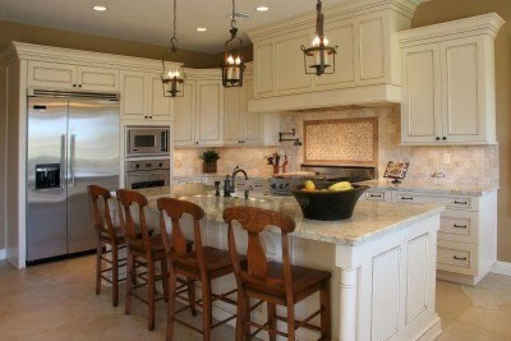 How to Plan Average Kitchen Remodel : Nice Looking Kitchen Design With L Shaped White Kitchen Cabinet And Island Bar Table Complete With Brown Wooden Bar Chairs And Rustic Iron Island Pendant Lamps
