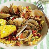 paella style quick clam bake ~ rachael ray ~ I've made this 4 times & we love it!  I use closer to 1 cup of beer and part of an unseeded jalepeno instead of a fresno pepper ~ delish!