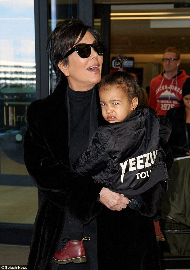 Make it stop! North West looked grumpy after her long-haul flight as she arrived at Heathrow airport in London on Monday morning alongside her grandmother Kris Jenner: