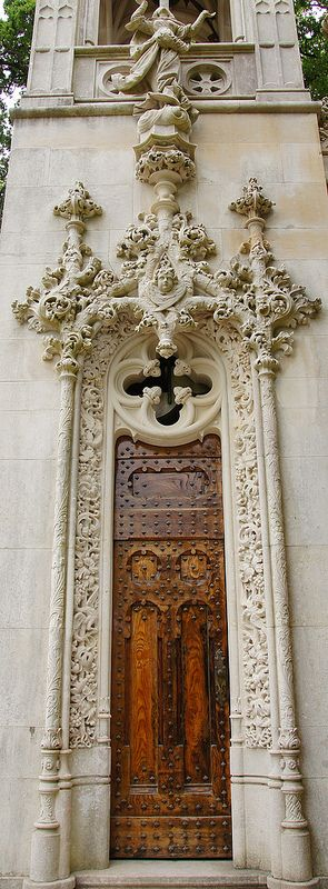 An ornately-embellished wooden for in Sintra, Portugal. Door to the World.
