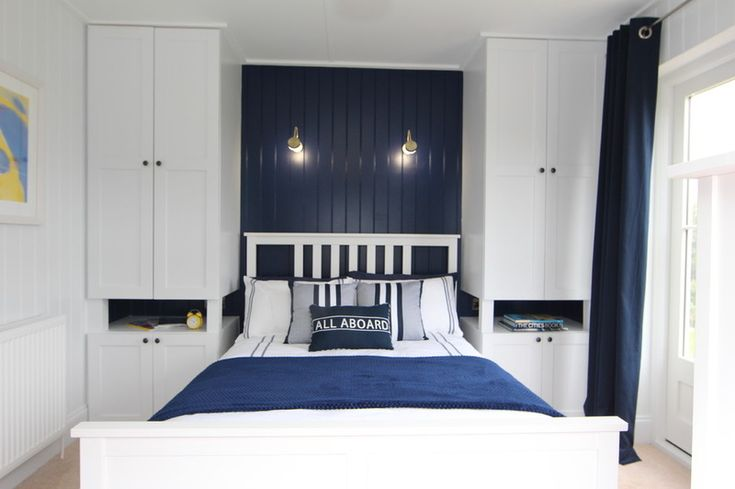 custom built-ins on either side of bed, serving as bedside tables and wardrobe/storage. Traditional Bedroom by The Wee House Company
