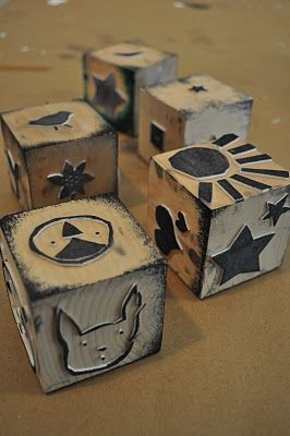Create your own foam stamp blocks...cut shapes, glue to wooden blocks, ink, print....very kid friendly, too....