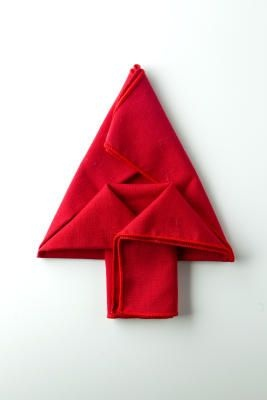 Napkin origami - follow the instructions for a cute little tree.