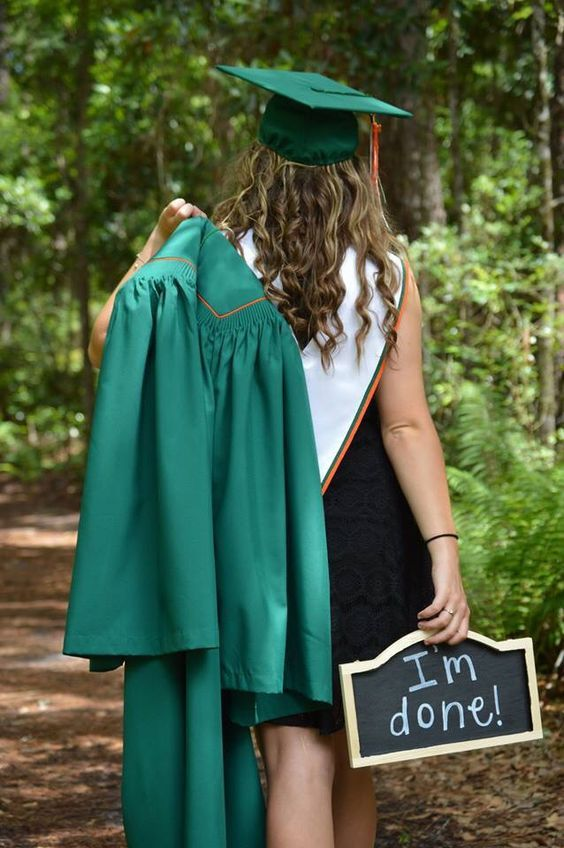 "This is a cute senior picture idea! Cap & Gown Pictures with an ""I'm Done!"" sign"