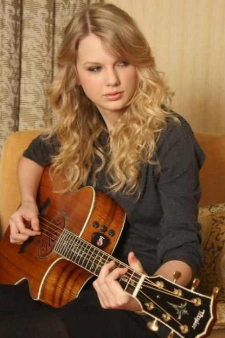 Taylor swift with a guitar