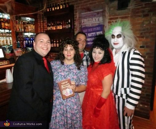 Rebecca: We decided to go as the cast of Beetlejuice this year. We even have the handbook and the business cards along with the ad from the movie!.