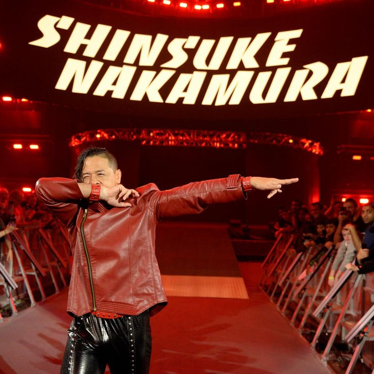 ... and the King of Strong Style obliges, entering the arena to a thunderous ovation.