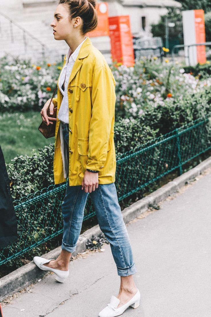 yellow raincoat, cuffed boyfriend jeans, and heeled loafers