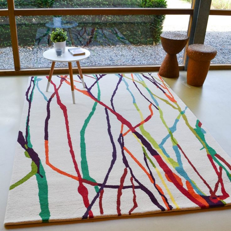 'We all love #abstract patterns because they allow us to define art according to our comprehension.' Estella Drip 878101 Wool Rug makes us imagine vibrant and multicoloured dancing sticks. We are sure it will produce myriad of vivid images in your mind as well. With the pure new wool content, the product becomes  super smooth, #highlydurable, resilient, and easy to maintain. #homedecor #interiordesign