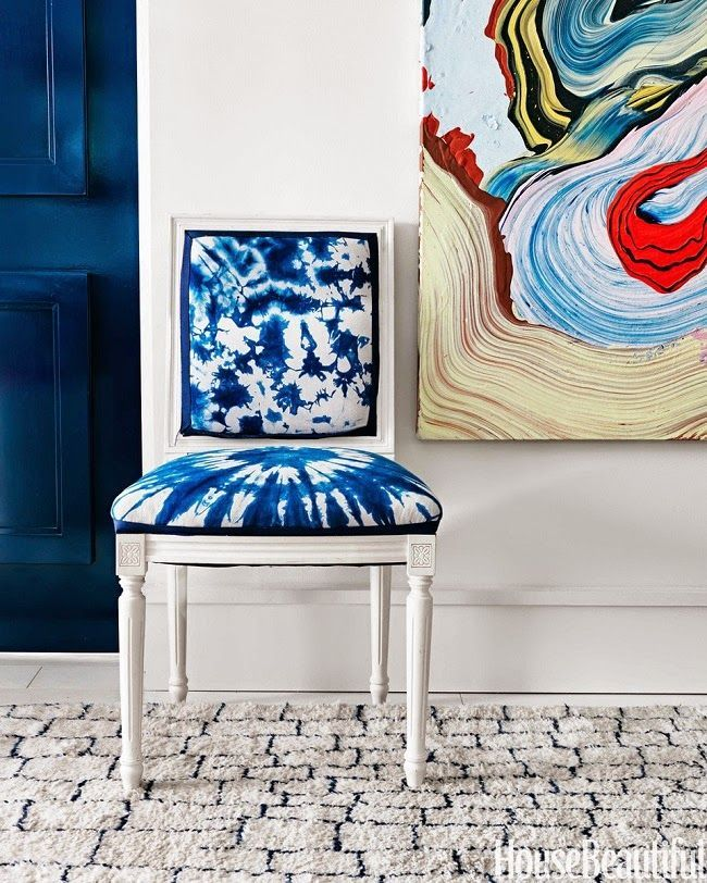 White chair with Shibori dyed upholstery, Like the carpet in this room too!