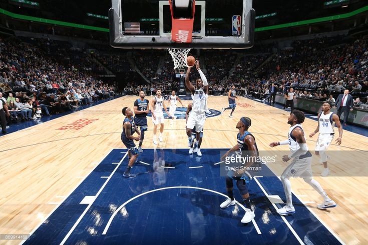 Harrison Barnes of the Dallas Mavericks shoots the ball against the Minnesota Timberwolves on December 10, 2017 at Target Center in Minneapolis, Minnesota.