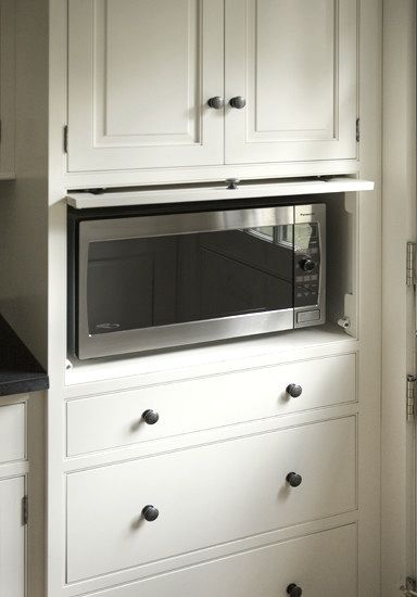 Traditional cabinetry with a built-in microwave slot; Heartwood Kitchens.