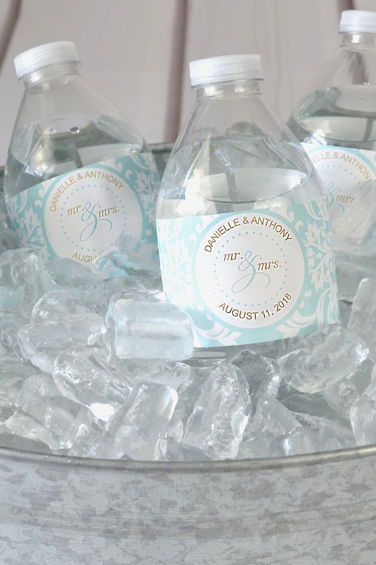 Mr & Mrs Damask design wedding water bottle labels printed in Tiffany blue damask pattern color with bride and groom's name and wedding date. These waterproof, vinyl, self-adhesive water bottle labels can be ordered at http://myweddingreceptionideas.com/damask-personalized-water-bottle-labels.asp