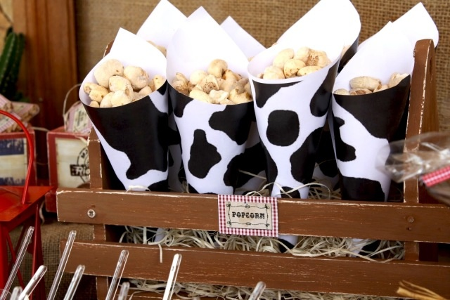 note to self...start looking for cow print paper...stuff with popcorn, cracker jacks, chex mix. Cute!