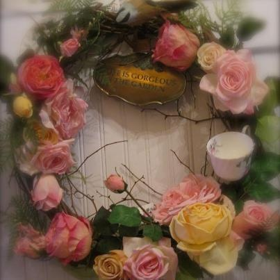 Silk florals, broken bits of china and a delicate cup add interest to this garden wreath.  Love how it turned out!
