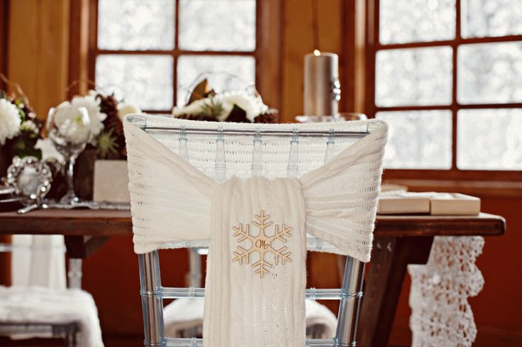 Wool scarf chair ties with wood, mr. and mrs. snowflakes by Naturally Chic.  Photo by Orange Girl Photography. #emeraldlakewedding #winterwedding
