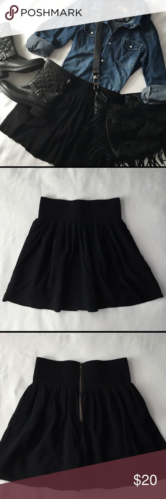 """Black A Line Mini Skirt w Exposed Zip-Like New Flowy black a line mini skirt.  Sits higher up on the natural waistline.  Features an exposed back zipper.  Approx 16.5"""" Super cute!! Bought at a boutique in SOHO.  Excellent condition. 🚫Sorry no trades. Sweet Candy Skirts Mini"""