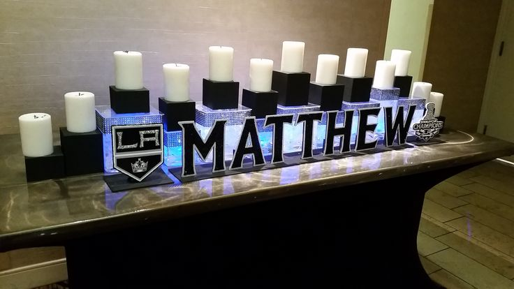 Hockey-themed candle lighting display for a bar mitzvah  Custom design by Invitation Maven