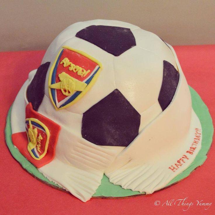 Birthday Cakes for Boys - Football Shaped Fondant Cake with Arsenal Symbol   All Things Yummy#arsenal #fan #football #footballcake #carvedcake #soccer #soccerfan #liqourcake #baileys #kahlua #sports #atyummy #cake #customisedcake