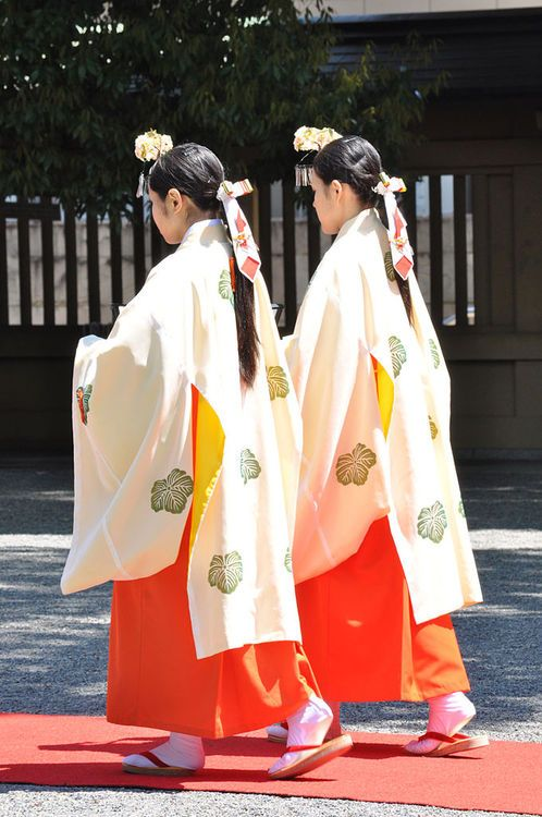 Miko costumed to perform kagura