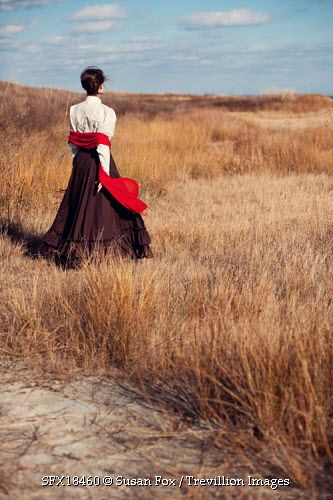 Trevillion Images - woman-standing-on-sand-dunes