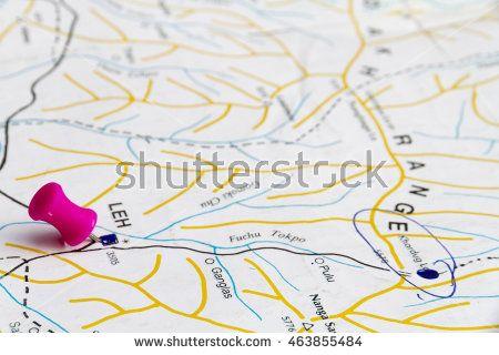 A hot pink pushpin on a map of Ladakh, Jammu and Kashmir, India