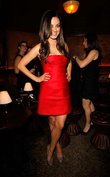 Mila Kunis. Love the red!