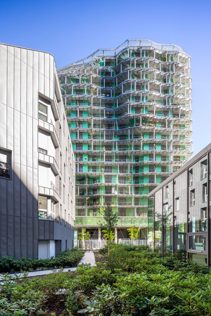Plants grow up the exterior of this green apartment tower in Paris, France, which was designed by local firm Masion Edouard Francois