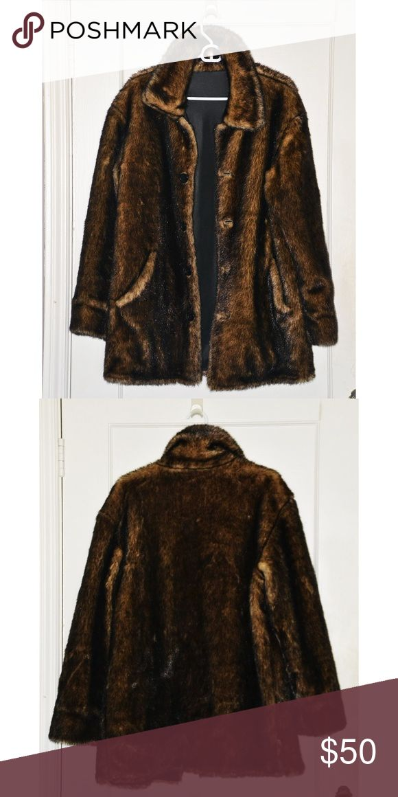 """Vintage Oversize Faux Fur Coat Insulated Gorgeous, heavy vintage faux fur coat. Lined and insulated for extreme cold weather wear.  Unlabelled but measurements are for a size Medium.  23"""" chest / 32"""" length / 23.5"""" sleeves. Excellent condition with him wear towards the seat of coat - may come out with dry cleaning. Vintage Jackets & Coats"""
