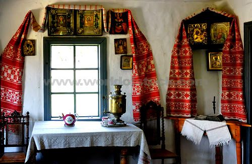 Ukrainian Decor - I brought home yards and yards of red and white embroidered fabric to replicate the look at home!