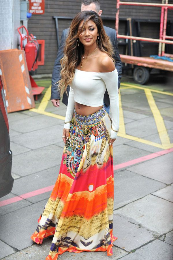 a colorful in a maxi skirt and off the shoulder crop top top