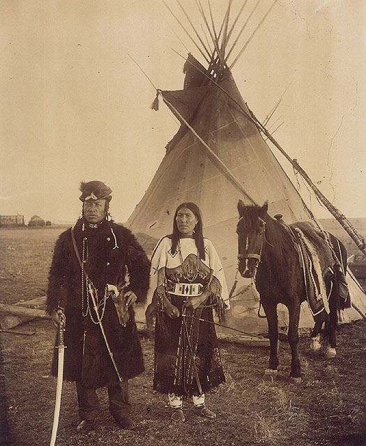 Dog Child, a North West Mounted Police scout, and his wife, The Only Handsome Woman, members of the Blackfoot Nation, Gleichen, Alberta, ca. 1890 / Dog Child, éclaireur de la Police à cheval du Nord-Ouest, et sa femme, The Only Handsome Woman, tous les de by BiblioArchives / LibraryArchives, via Flickr