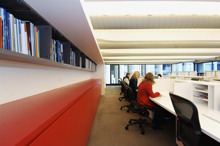 The main work space provides shelving for previous company annual reports designed by RBA. An open plan allows designers to discuss details freely. Brooke Aitken Design.