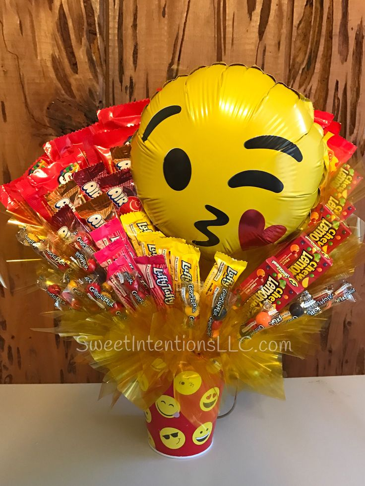 Emoji Candy Bouquet made by Sweet Intentions, LLC. Contains Skittles, Laffy Taffy, Gobstoppers , Starbursts and Chewy Lemonheads for more designs, see https://www.facebook.com/SweetIntentionsLLC/. #CandyBouquet, #EmojiBouquet, #SkittlesBouquet