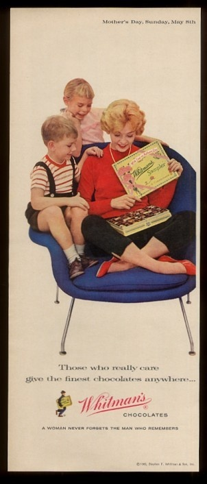 Eero Saarinen's Womb Chair shown in an advertisement for Whitman's Chocolates.