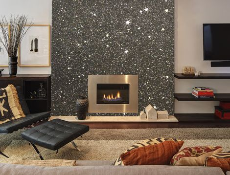 Gunmetal grey Glitter wallpaper featured on a Chimney Breast wall. 5 Metres of Glitter used here for £195.00. This wallcovering is available in over 70 colours and two different textures. Click through to see all the colours.
