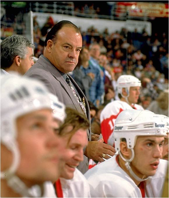Scotty Bowman, Detroit Red Wings.  NHL's winningest coach, 1,244 regular season wins, 223 playoff wins.  Won the cup with the Wings in 1997, 1998, and 2002.
