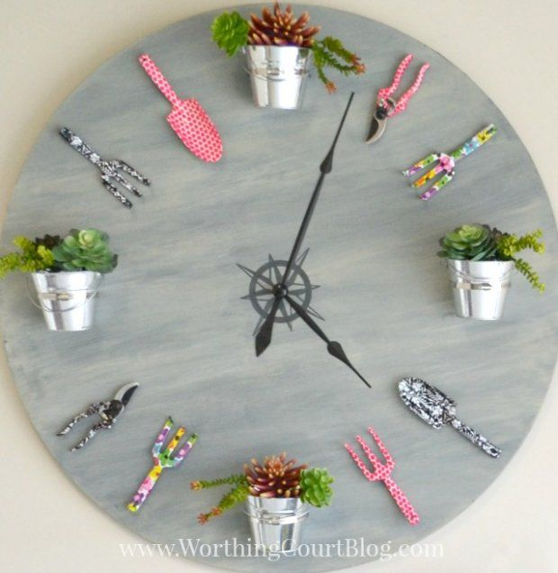 """If you have some paint, an old table top, some gardening tools, and clock hands, you have all the makings for this fun garden clock! Worthington Court gives you a complete step-by-step tutorial on <a href=""""http://www.worthingcourtblog.com/2015/02/how-to-make-a-garden-clock.html"""" target=""""_blank"""">how to make a garden clock</a>."""