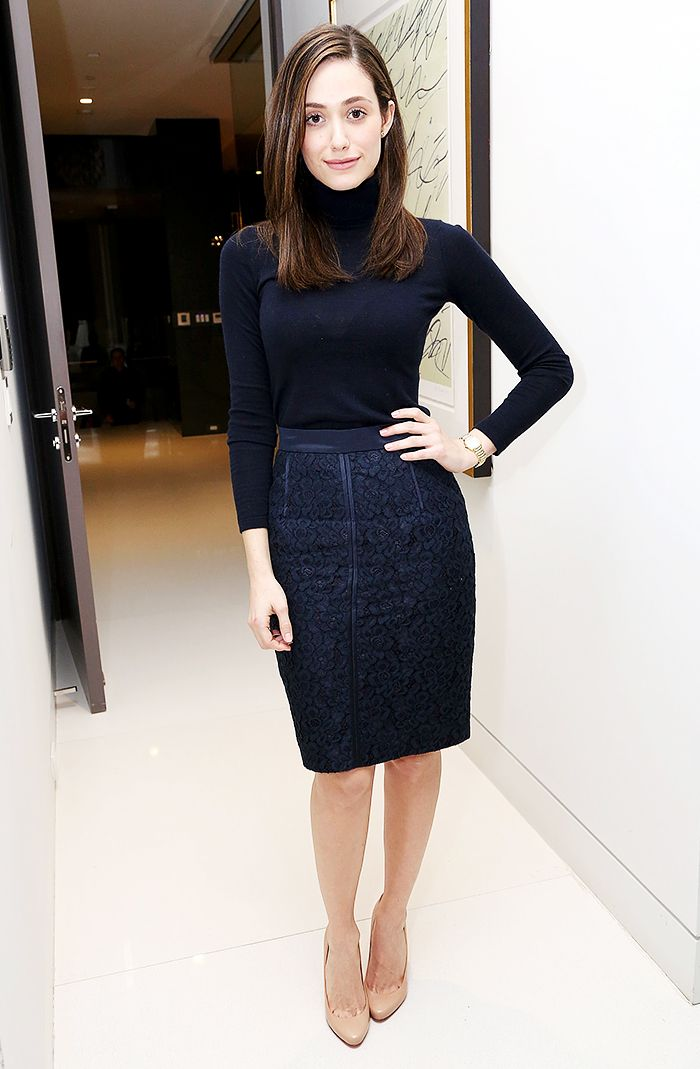 Emmy Rossum in a monochromatic look: navy turtleneck + lace pencil skirt and nude pumps for a slimming effect