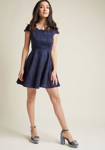 Faux-Suede Skater Dress with Scalloped Neckline - When it comes to describing just how darling this navy skater dress really is, 'flirty' only cracks the surface! A ModCloth exclusive, this date night must-have is a delight to your sight with its scallop-detailed neckline and flared skirt, and a treat to the touch from its faux-suede fabric. Talk about sensory chic!
