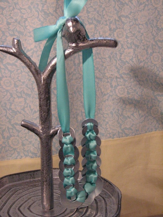 Love jewelry that makes you really look at it...this is made of washers and ribbon -  gorgeous!