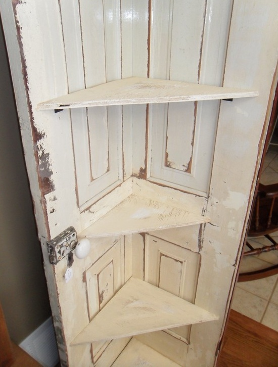 Antique door repurposed as a corner bookcase or take the 2 top selves off and put hooks on it where u could hang jackets on